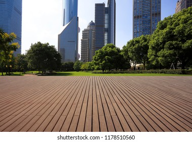 Empty wood floor surface with modern city landmark buildings backgrounds in Shanghai