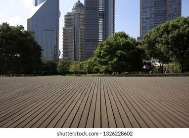 Empty wood floor surface with modern city landmark buildings backgrounds in Shanghai