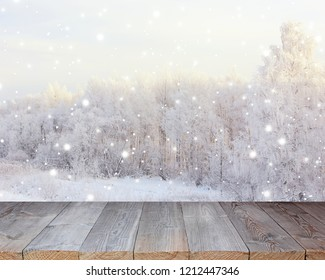 Empty wood flooring on blurred winter background. Empty space for Your object. backdrop, layout of the table with winter trees and snow.