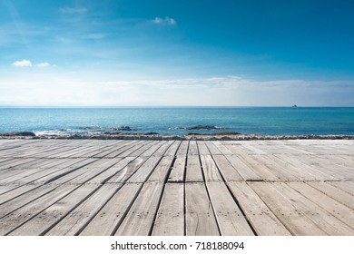 Empty wood on blus sky and sea background