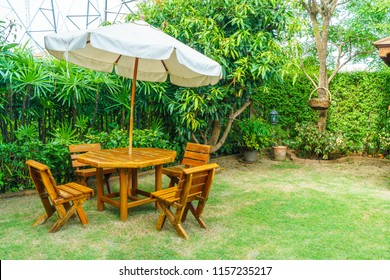 empty wood outdoor patio table and chair decoration in home garden