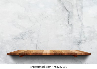 Empty wood plank shelf at white marble wall background,Mock up for display or montage of product or design