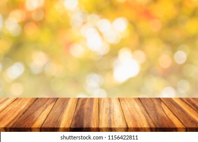 Empty wood table with abstract yellow bokeh background. For display or montage your products.