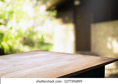 empty wood table with blur montage outdoor garden background.