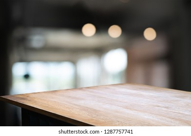 empty wood table with blur montage coffee shop cafe background.