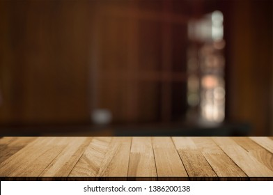 empty wood table with blur montage restaurant background