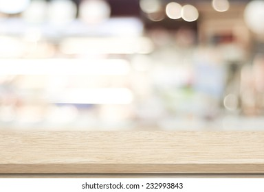 Empty wood table and blurred cafe with bokeh light background. product display template