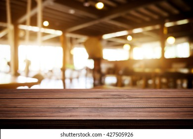 Empty wood table and blurred of cafe light background. product display template. Business presentation.