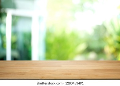empty wood table with blurred montage nature green place background.