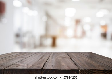 Empty wood table and blurred white bokeh light coffee shop background. product display template. Business presentation.