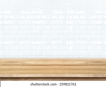 Empty wood table and ceramic tile brick wall in background. product display template