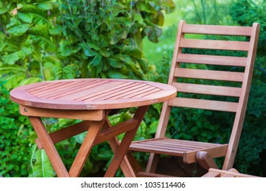 empty wood table and chair on the terrace at summer day