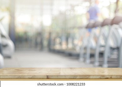 Empty wood table in gym interior background.