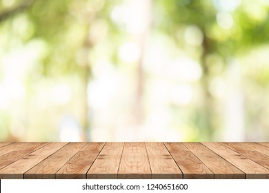 Empty wood table on blurred background copy space for montage your product or design,Blank brown board with abstract blurred background