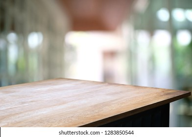 empty wood table over blurred outdoor cafe background.