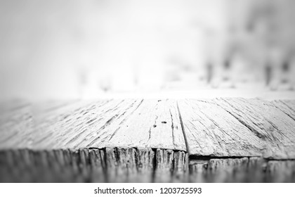 empty wood table for product display and montage with blurred white background. black and white wooden table for background.