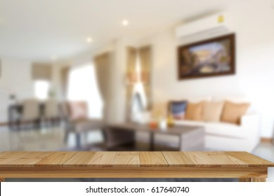 Empty wood table space platform and living room background.  Product display montage Concept.