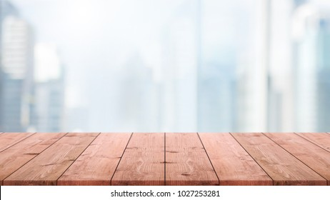 Empty wood table top and blur glass window wall building background with vintage filter - can used for display or montage your products.