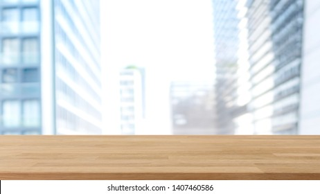 Empty wood table top and blur glass window wall building banner mock up background - can used for display or montage your products.