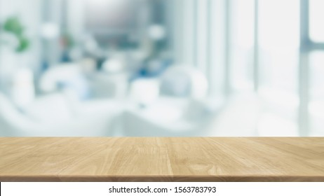 Empty wood table top and blur glass window interior restaurant banner mock up abstract background - can used for display or montage your products.
