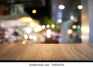 Empty wood table top and blur of night market background/selective focus .For montage product display