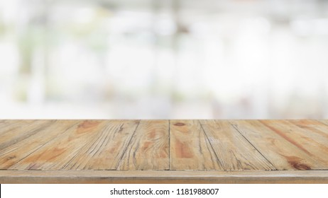 Empty wood table top and blurred restaurant interior background - can used for display or montage your products.