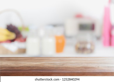 Empty wood table top and blurred kitchen interior background - can used for display or montage your products.