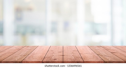 Empty wood table top and blurred abstract restaurant interior background - can used for display or montage your products.