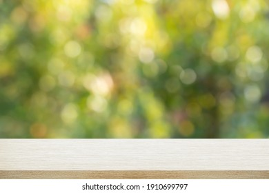 Empty of wood table top with blurred bokeh abstract background.For montage product display or design key visual layout