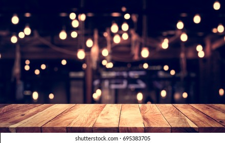 Empty of wood table top with blurred light gold bokeh abstract background.For montage product display or design key visual layout