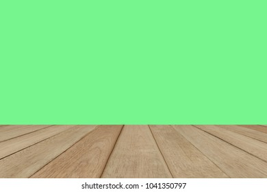 Empty wood table top on isolated green background for montage or display product.