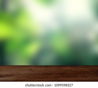 Empty wood table top on blur abstract green from garden in morning background. For montage product display