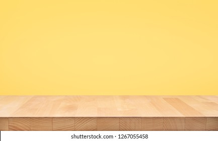 Empty of wood table top on yellow pastel color background.For montage product display or design key visual layout