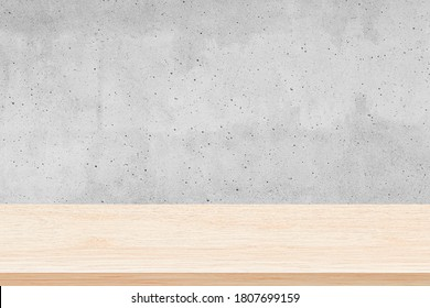 Empty wood table top on gray concrete wall background, Used for display or montage your products