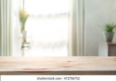 Empty of wood table top on blur of curtain window glass  with sunlight background.For montage product display or design key visual layout.