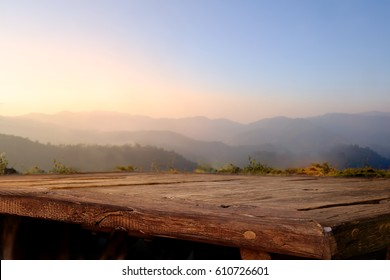Empty wood table top on blur background of mountain. For display or montage your products.