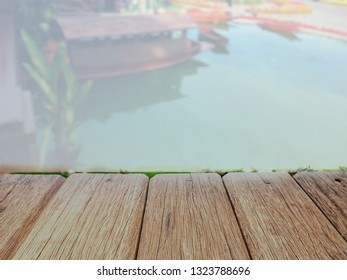 empty wood table with vintage river background for product display or montage.