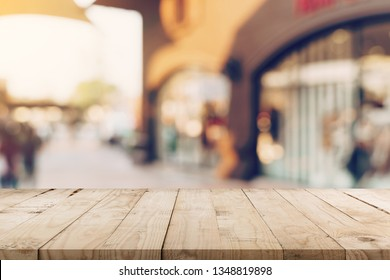 Empty wood table and Vintage tone blurred defocused of crowd people in walking street festival and shopping mall.