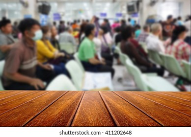 empty wooden for advertising board on blurred people and patient waiting for the doctor, hospital and health care concept  background