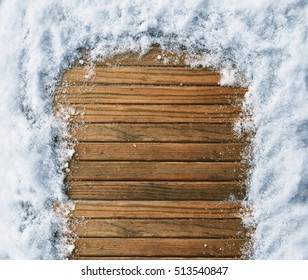 empty wooden background with snowflakes. top view. place for text