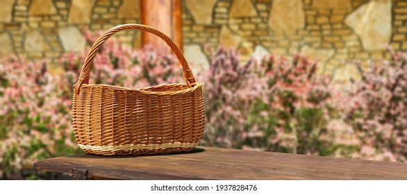 Empty wooden basket of free space for your decoration and spring flowers