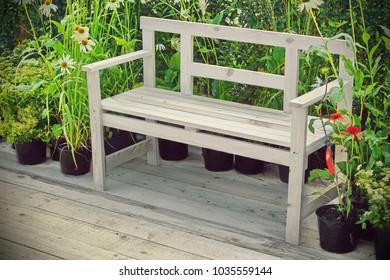 Empty Wooden Bench On The Backyard Wood Patio, Close Up. Modern Garden Detail