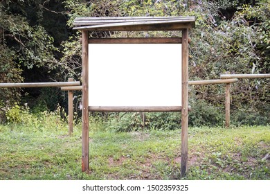 Empty wooden billboard in the nature. Signboard made of wood with white space for text and graphics (the aspect ratio of placard is 3:2)
