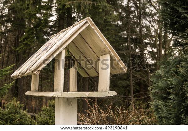 a empty wooden bird feeder