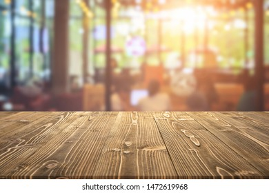 Empty wooden board or table and abstract blurred background. Free space can be used for photo montage or product display design and advertising