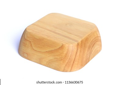 Empty wooden bowl over white