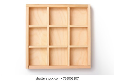 empty wooden box with compartments to store on white