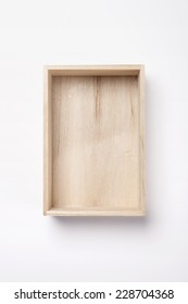 A empty wooden box isolated white, top view.