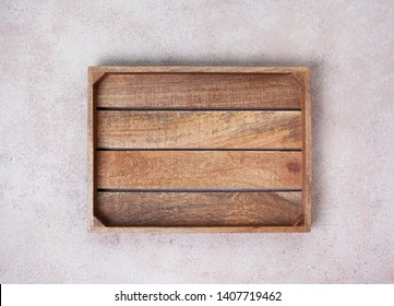 empty wooden box on concrete background. view from above. copy space