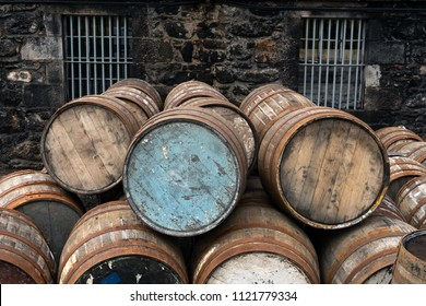 Empty wooden casks on the warehouse yard prepared for scotch whisky at a distillery
